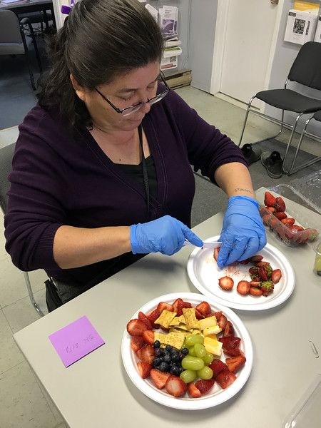 Community Legal Worker Pauline Sackaney preparing strawberries for board meeting 2017 October 3rd.