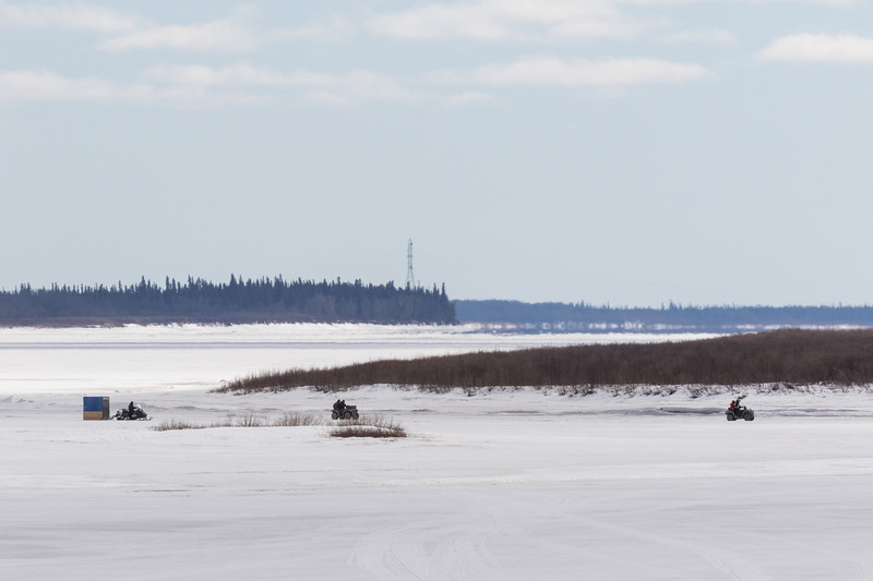 Snowmobile taxi and all terrain vehicles on the Moose River at Moosonee. 2017 April 7th.
