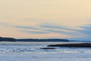 Ice and clouds up the Moose River from Moosonee.