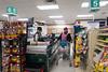 Clerk Maryann Friday with customer Denise Lantz at checkout 6 at Moosonee Northern 2017 June 25th.