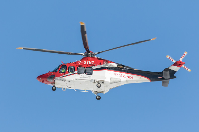 ORNGE ambulance helicopter C-GYNZ heads back to its base in Moosonee from Moose Factory Island.