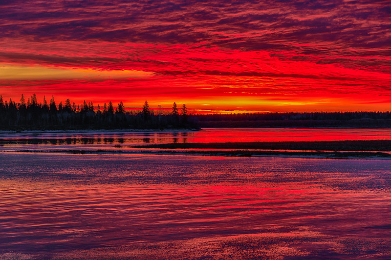 Purple sky before sunrise over Butler Island reflected in the water of the Moose River at Moosonee. HDR efx tone mapped dark. Blues reduced.