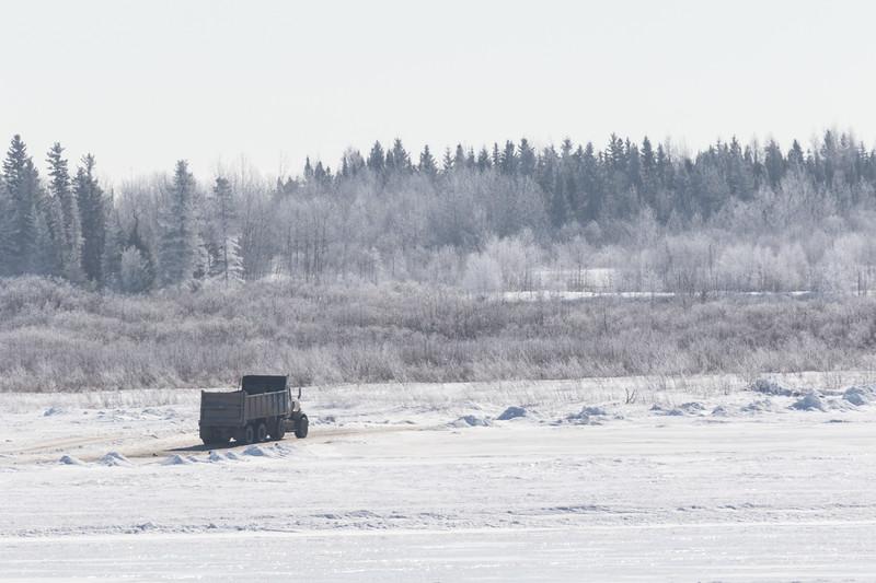 Dump truck on the Moose River headed towards Moose Factory Island. Gravel haul.
