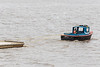 Moosonee Transportation Limited workboat MTL1 bringing a section of docks up the river in Moosonee for installation.