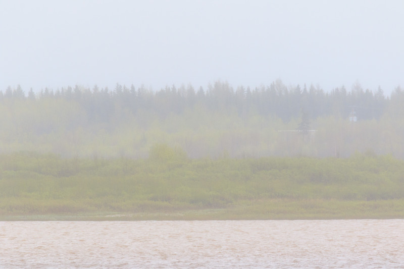 Fog and rain across the river.