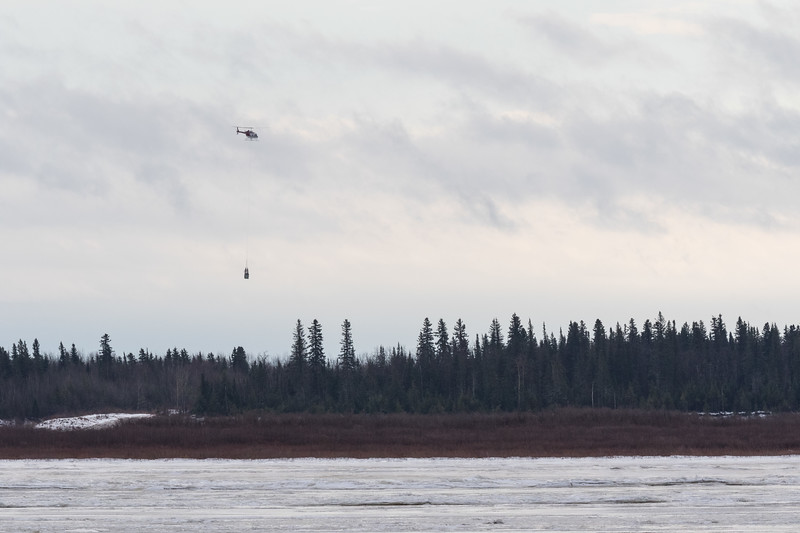 Helicopter slinging goods to Moose Factory. 2017 December 5th.