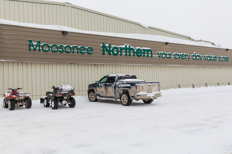 Moosonee Northern your every day value store sign with snow.
