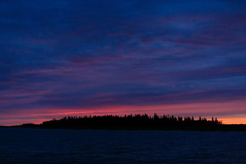 Butler Island under cloudy skies before sunrise.