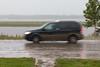 Taxi on Revillon Road in the rain.