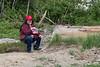 Denise Lantz sitting at site of former water tower in Moosonee.