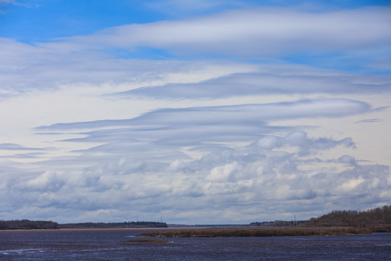 Clouds down the Moose River with a polarizing filter.