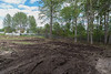 Cleared area at corner of Ferguson Road and Fourth Street in Moosonee 2017 June 24th. Looking towards Fourth Street.