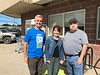 jeff Schlemmer and Monica Wolf from Neighbourhood Legal Services in London with Paul Lantz outside Northern Store in Moosonee.