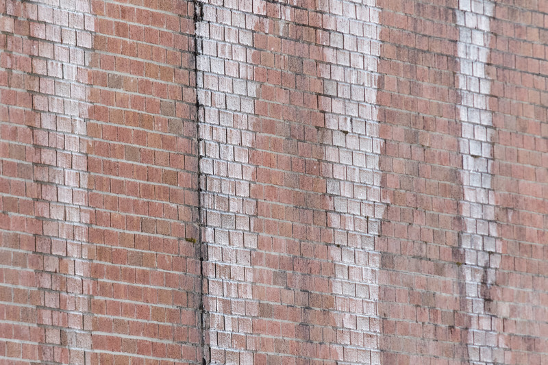 Ice on brick wall at Ontario Government Building in Moosonee.