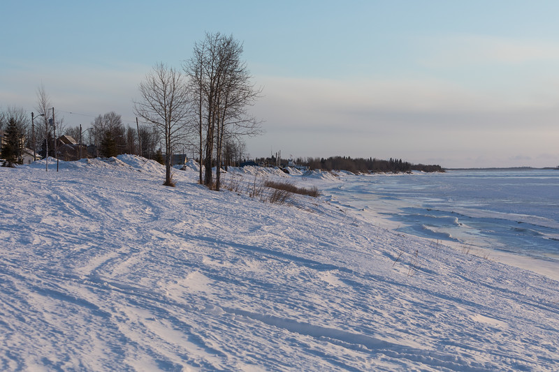 Moose River shoreline looking down the river from near Butcher Street. Snow has a relatively strong hard crust.