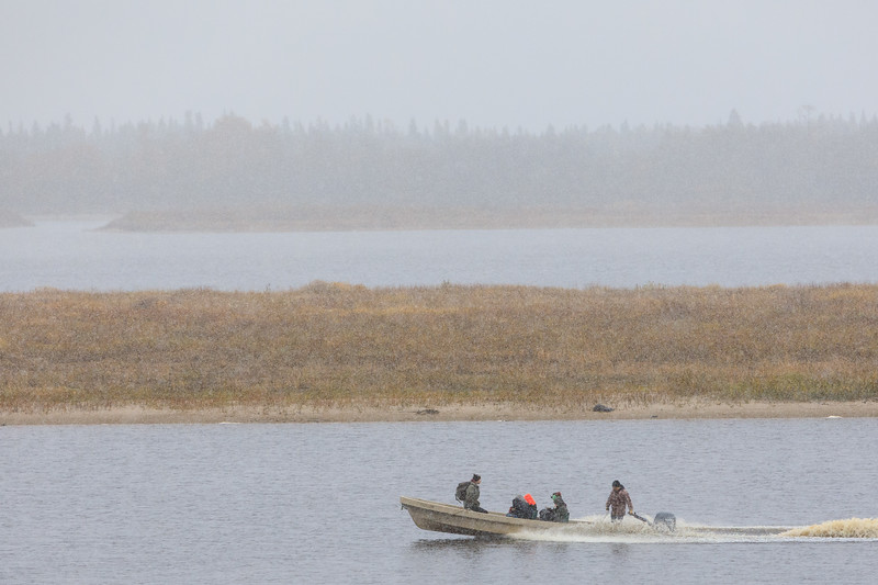 Canoe on the Moose River on a Sunday morning with the first snow of the season falling.