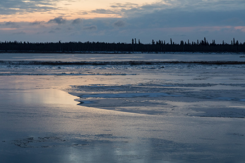 Ice sheets on the Moose River at Moosonee before sunrise.