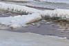 Broken ice along the tidemark of the Moose River at Moosonee.