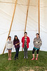 Articling student Ruchi Punjabi with the Chakasim girls in a tipi.