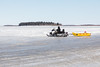 Snowmobile and sled on the Moose River.