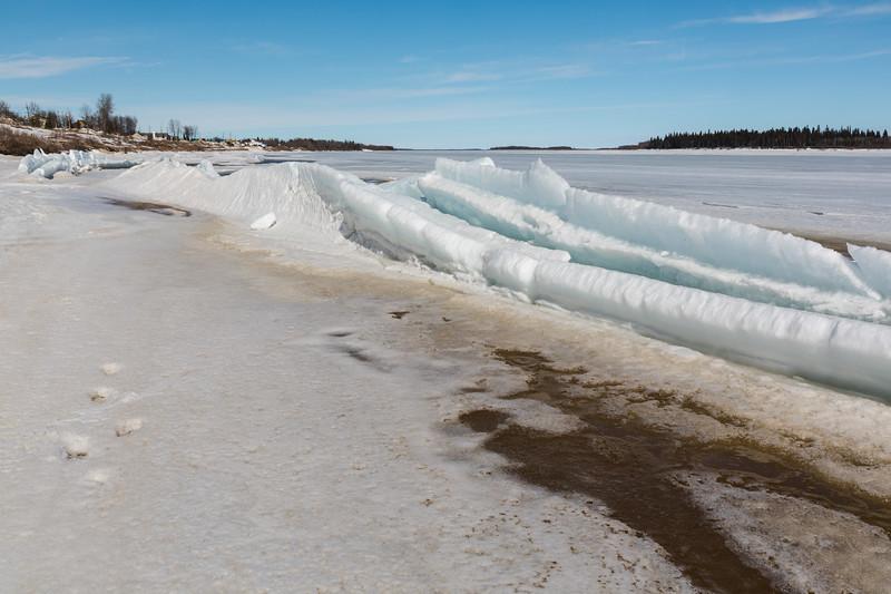 Broken ice along the tidemark near public docks.