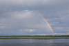 Partial rainbow and hint of a second rainbow across the Moose River from Moosonee.