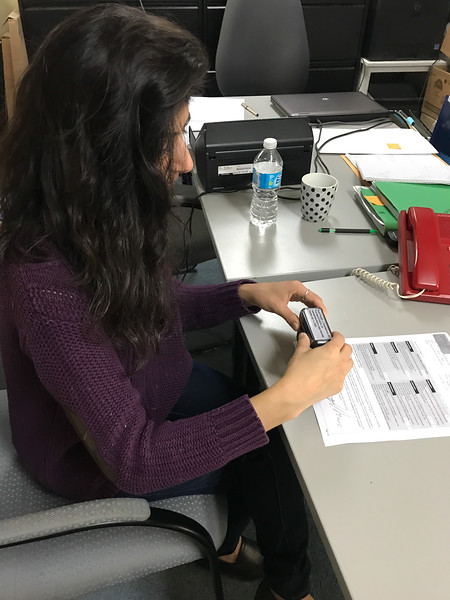 Articling student Ruchi Punjabi commissioning a document at Keewaytinok Native Legal Services.