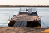 Barge loaded with a trailer docked in Moosonee.