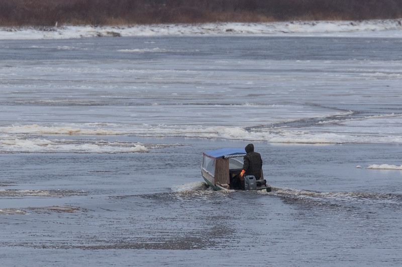 Taxi boat on the Moose River with ice.