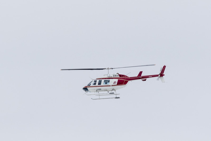 Huisson Aviation helicopter C-GZRS over the Moose River.