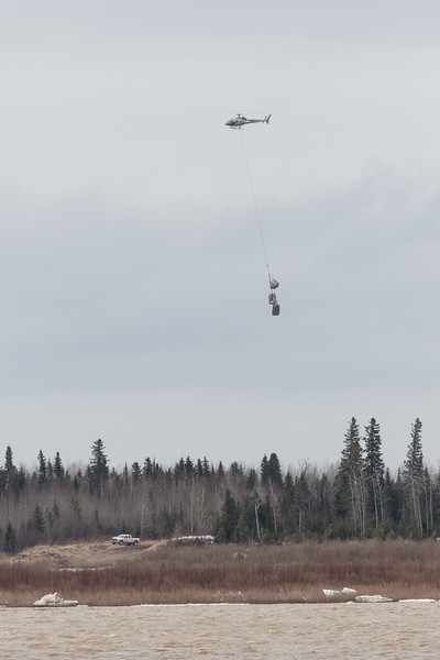 Helicopter slinging loads to Moose Factory 2017 May 2nd.