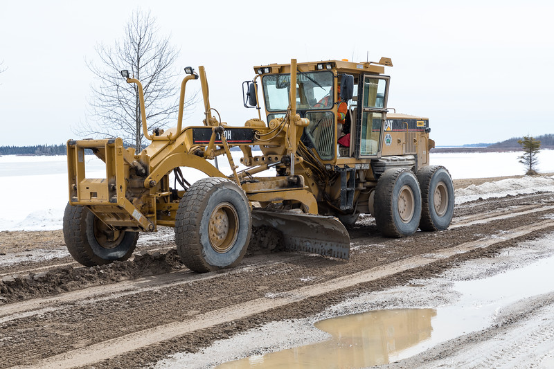Grader working on Revillon Road.