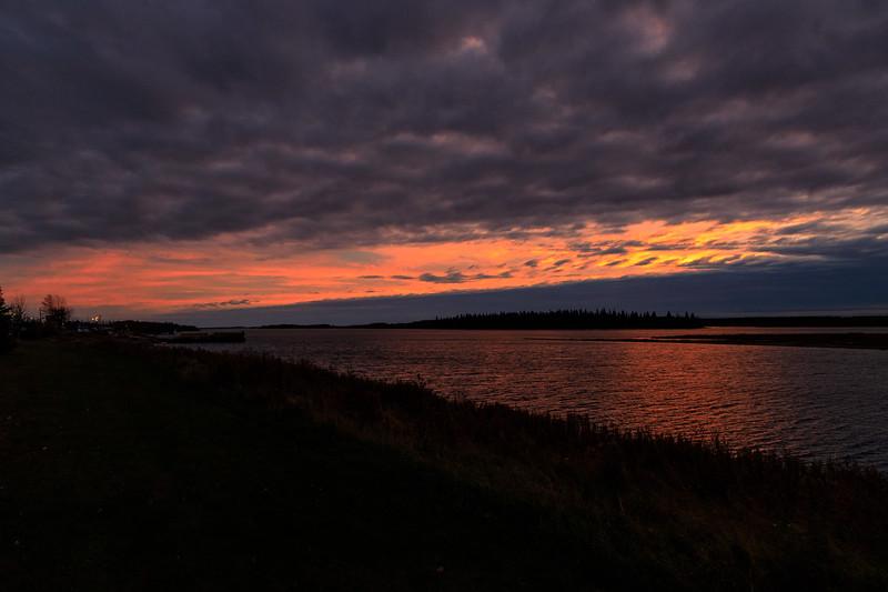 Looking down the Moose River before sunrise showing Moosonee shoreline. 2017 October 13th.