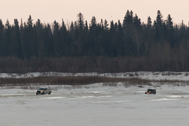 Vehicles heading on to the Moose River from Moose Factory.