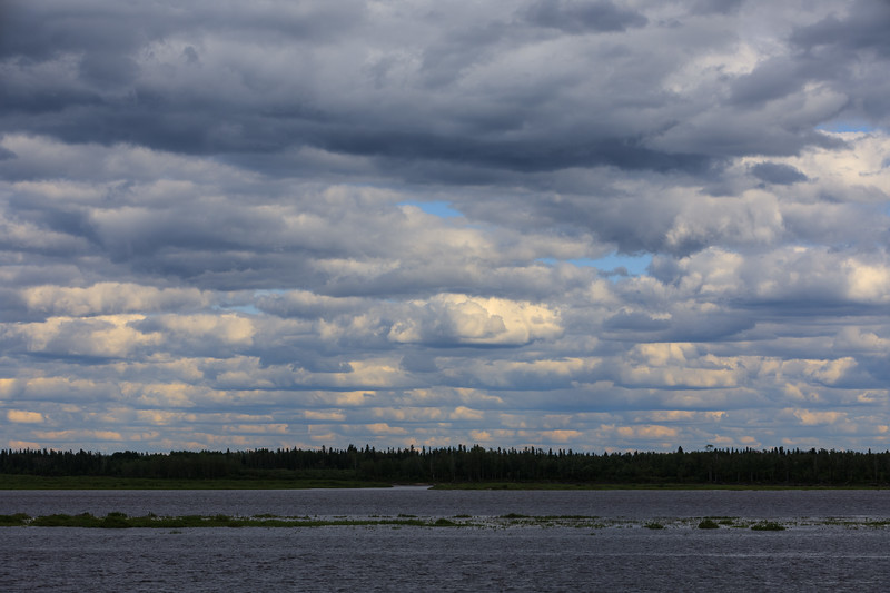 Long narrow clouds across the Moose River.