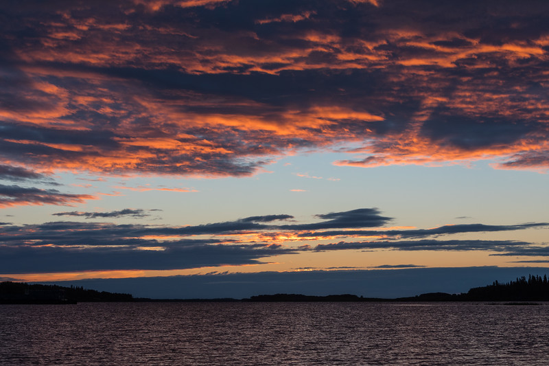 Purple clouds above looking down the Moose River before sunrise.