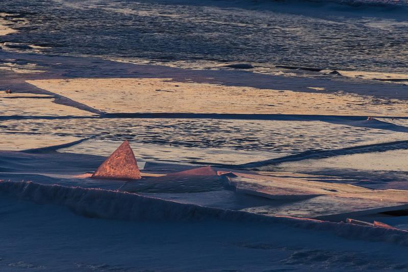 Broken ice along the tidemark at sunrise.