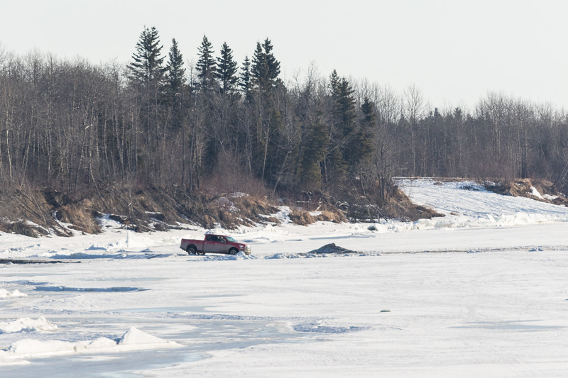 Truck heading on to the Moose River from Airport Road. 2017 April 2nd.