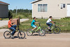 Three boys on bicycles on Moose Drive.