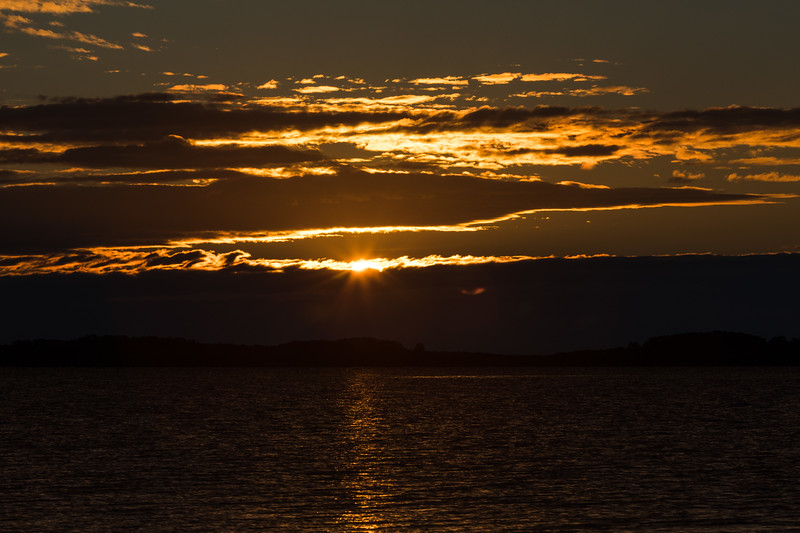 Sunrise down the Moose River on a morning with low clouds.