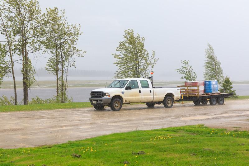 Truck on Revillon Road in heavy rain.