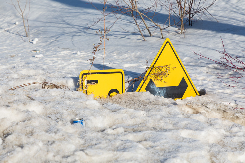 Road sign in the snow.