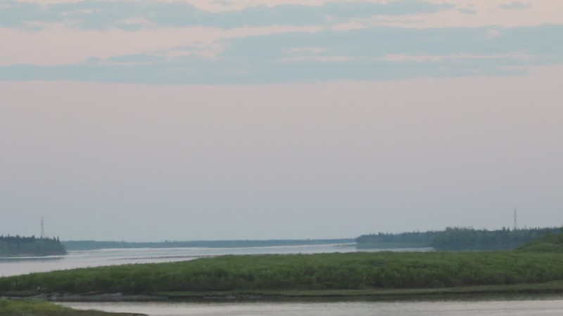 New lights on hydro towers up the Moose River from Moosonee that carry power to Moose Factory Island. 2017 June 7th.