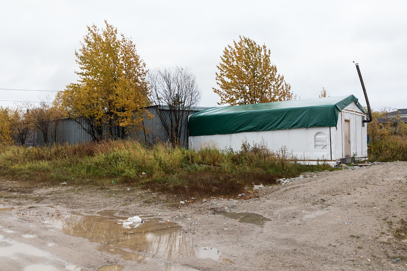 Work area erected behind building at corner of Wabun Road and Cotter Street.