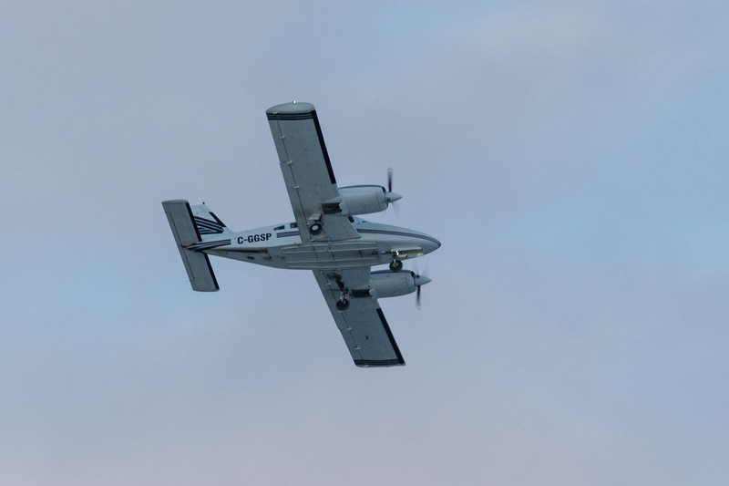 Piper PA-34-200T twin engine aircraft over Moosonee just before sunset 2017 March 31st.