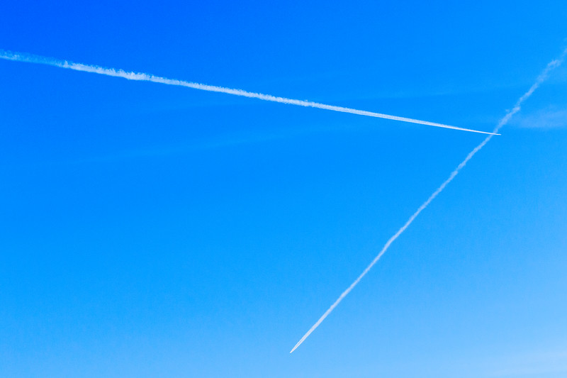 Contrails crossing in the sky.