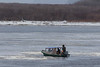 Taxi boat weaving its way through ice on the Moose River.