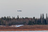 Helicopter dropping off goods in Moose Factory.