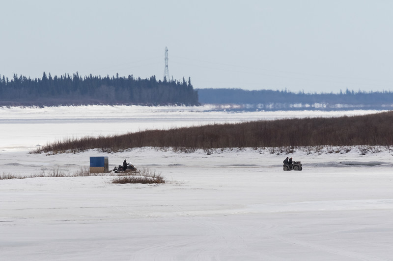 Snowmobile txi and all terrain vehicle on the Moose River at Moosonee.