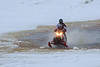 Snowmobile going through water along the tide mark on the Moose River 2017 January 21st.